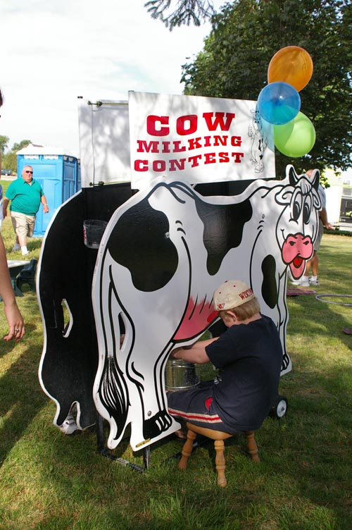 Trade Show Booth Games : Cow milking contest carnival game rentals