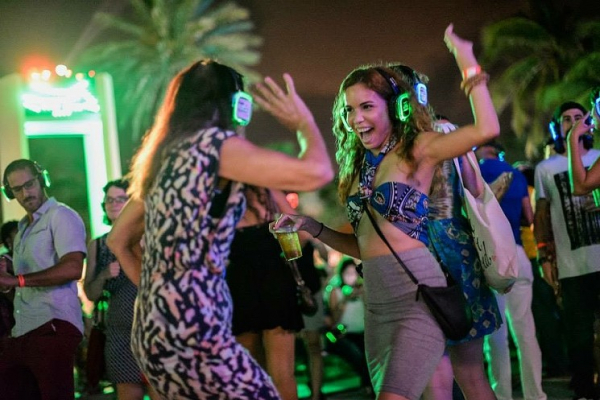 Young women at a Silent Dance Party