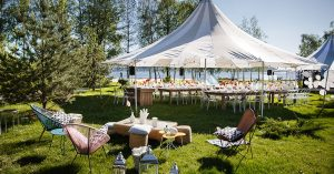Outdoor tent, tables and chairs.