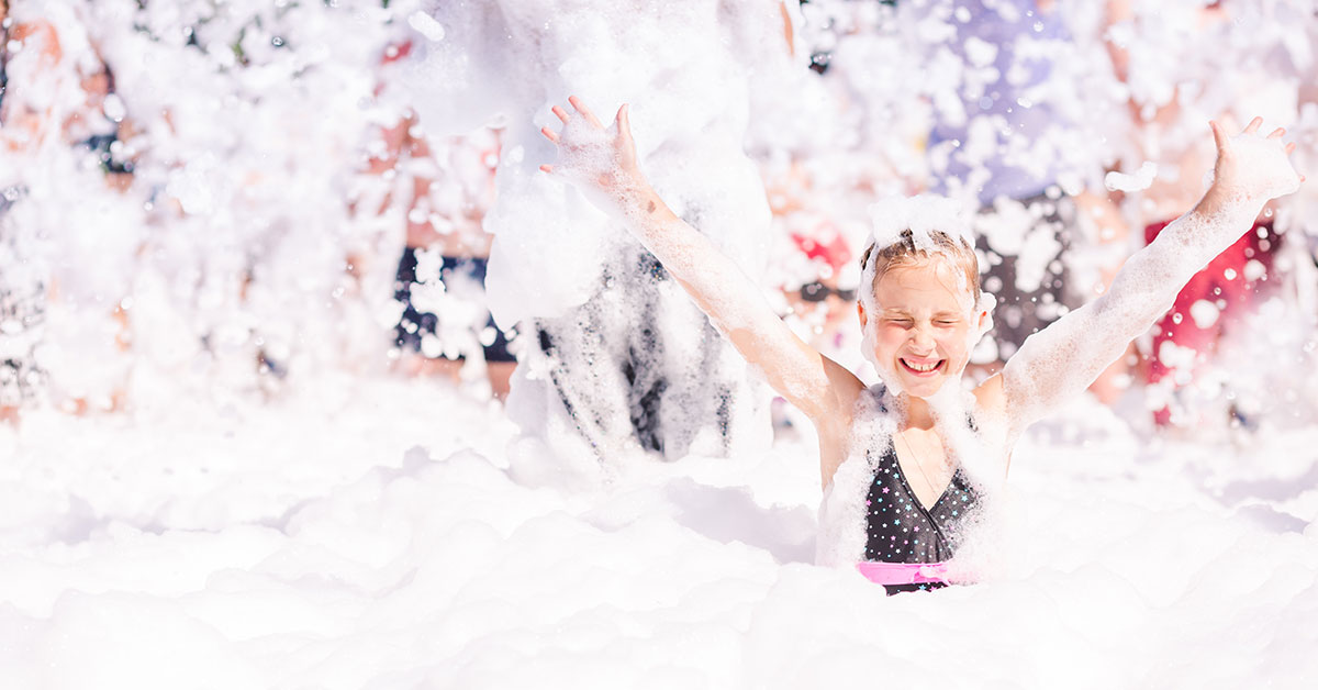 Girl having fun at a foam party.