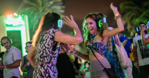 Two women enjoying a silent disco party.